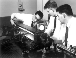 engineers working on experiment long ago