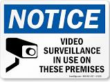 security camera warning posted sign