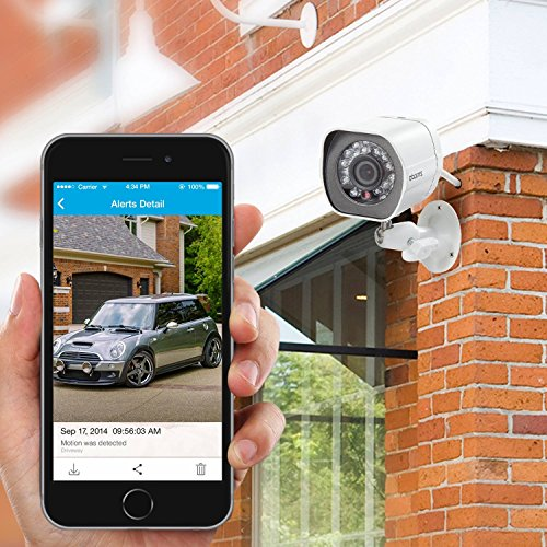 zmodo security camera and smartphone live viewing in persons hand